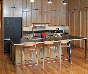 Loft living. The open kitchen in this loft sits adjacent to the living room. Designed for entertaining and for its passionate cooks, the kitchen features an island top that was created with wheelchair accessibility in mind.